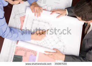 stock-photo-above-view-of-engineers-over-blueprints-during-work-planning-35087530