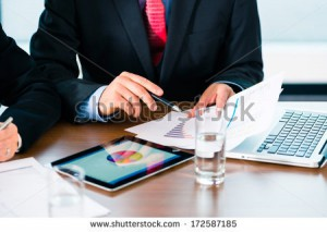 stock-photo-business-banker-manager-or-expert-evaluates-the-figures-on-tablet-computer-and-compares-the-172587185