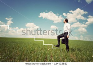 stock-photo-businessman-in-white-shirt-walks-up-the-ladder-in-the-green-field-124432657