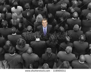 stock-photo-high-angle-view-of-a-businessman-standing-amidst-businesspeople-119909311