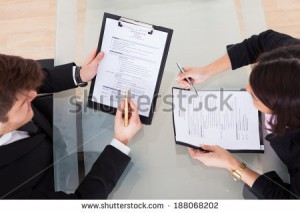 stock-photo-high-angle-view-of-business-people-discussing-over-documents-at-desk-in-office-188068202
