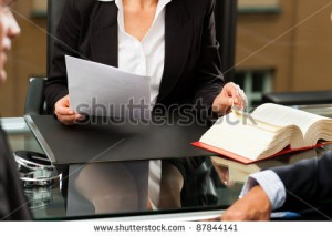 stock-photo-mature-female-lawyer-or-notary-with-client-in-her-office-for-counseling-87844141