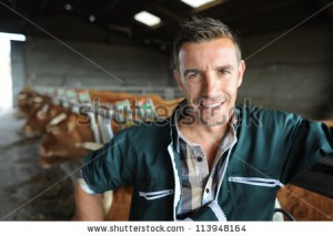 stock-photo-portrait-of-smiling-breeder-in-barn-113948164