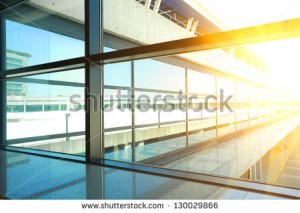 stock-photo-modern-blue-glass-wall-of-office-building-130029866